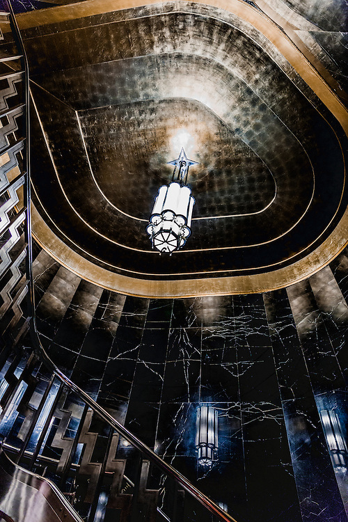 An Art Deco chandelier in a black marble stairwell adjacent to the Chrysler Building's main lobby