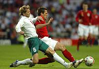 Photo: Leigh Quinnell.<br />England 'B' v Belarus. International Friendly. 25/05/2006.<br />England's Michael Owen battles with Vitaly Bulyga.