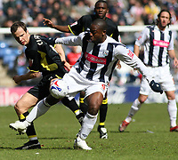 Photo: Mark Stephenson.<br /> West Bromwich Albion v Birmingham City. Coca Cola Championship. 18/03/2007.West Brom's Nathan Ellington holds up the ball from Birmingham's Stephen Clemence