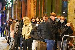 © Licensed to London News Pictures. 5/12/2020 Liverpool, UK.  Revellers queue  to enter a bar in Liverpool city centre  after lockdown restrictions were eased. Photo credit: Ioannis Alexopoulos/LNP