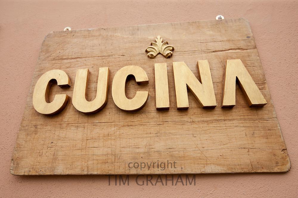 Cucina kitchen sign in Piazza Bucciarelli, Panzano-in-Chianti, Tuscany, Italy