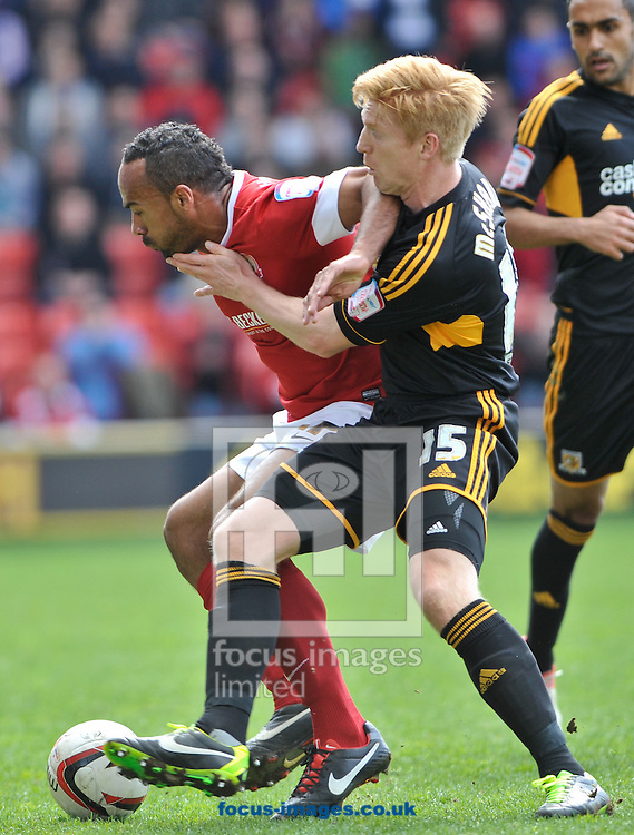 Picture by Richard Land/Focus Images Ltd +44 7713 507003.27/04/2013.Chris O'Grady of Barnsley and Paul McShane of Hull City during the npower Championship match at Oakwell, Barnsley.