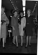 09/03/1964<br /> 03/09/1964<br /> 09 March 1964<br /> McBirney's Fashion show at McBirney's, Aston Quay, Dublin. Image shows three models displaying some of the range, (l-r) Mary wearing a red suit; Blanche wearing a ellow suit and Madge wearing a green suit.