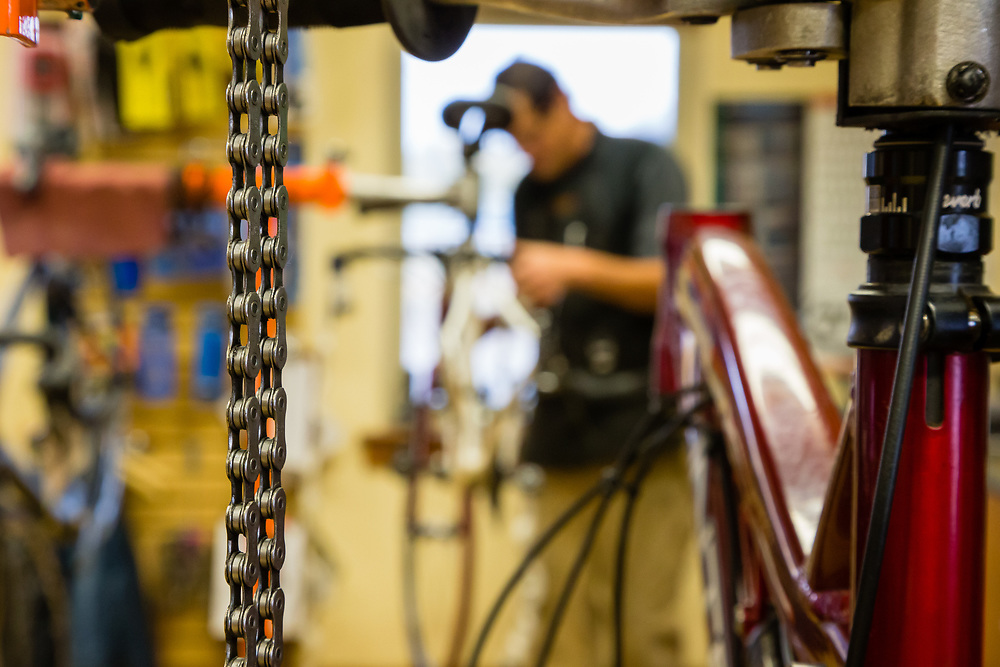Lloyd Wiser works on a bike in the maintenance shop of Fitzgerald's Bike Shop.