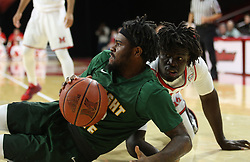 November 14, 2017 - Oxford, Ohio, U.S - Wright State Raiders guard Tye Wilburn (12) keeps Miami (Oh) Redhawks forward Precious Ayah (5) down . On Tue Nov 14,2017. During Redhawks game Wright State Raiders in Oxford,Ohio. As the Redhawks win in over time 73 to 67. (Credit Image: © Ernest Coleman via ZUMA Wire)