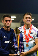 Sale Sharks centre Sam James with brother Luke James pose with the trophy after their 27-19 victory in The Premiership Rugby Cup Final at The AJ Bell Stadium, Eccles, Greater Manchester, United Kingdom, Monday, September 21, 2020. (Steve Flynn/Image of Sport)