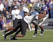 Kansas State kick returner Yamon Figurs (16) gets laid out by Colorado's Tyrone Henderson (3) and Lionel Harris (25) in the first half at KSU Stadium in Manhattan, Kansas, October 29, 2005.  The Buffaloes beat K-State 23-20.