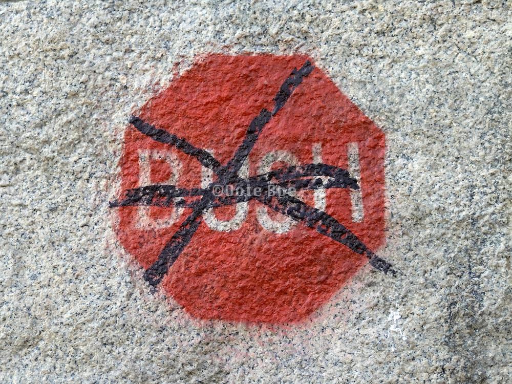 anti Bush graffiti on a stone in New york City