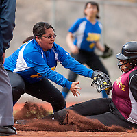 042613       Cable Hoover<br /> <br /> Rehoboth Lynx Jordan Ortega (22) slides into third as Zuni Thunderbird Samantha Cooeyate (24) reaches for the tag Thursday at Ford Canyon Park.