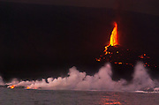 April 21, 2009: La Cumbre volcano erupts lava into the Pacific Ocean creating steam clouds and expanding Fernandina (Narborough) Island, in the Galápagos Islands, a province of Ecuador, South America. This eruption cycle started April 10, 2009 after 5 years of quiet. Fernandina Island was named in honor of King Ferdinand II of Aragon, who sponsored the voyage of Columbus. Fernandina is the youngest and westernmost island of the Galápagos archipelago, and has a maximum altitude of 1,494 metres (4,902 feet). In 1959, Ecuador declared 97% of the land area of the Galápagos Islands to be Galápagos National Park, which UNESCO registered as a World Heritage Site in 1978. Ecuador created the Galápagos Marine Reserve in 1998, which UNESCO appended in 2001.