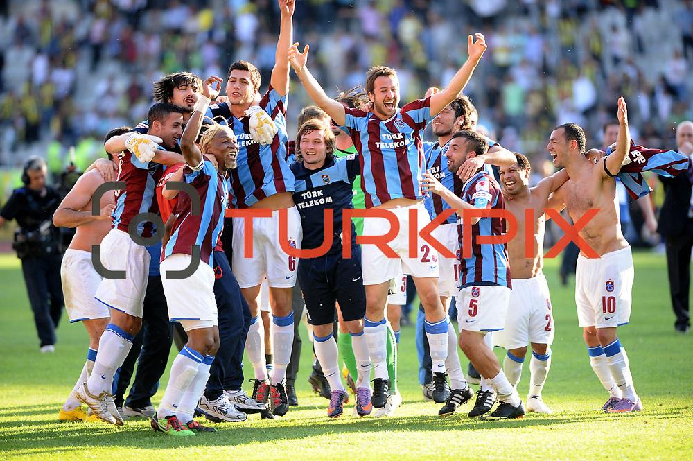 Trabzonspor's players (Left to Right) Rigobert Song BAHANAG, Ceyhun Gulselam, Remzi Giray KACAR, Engin BAYTAR, Alan Carlos Gomes Da COSTA, Umut BULUT celebrate victory during their Turkey Cup final match Trabzonspor between Fenerbahce at the GAP Arena Stadium at Urfa Turkey on wednesday, 05 May 2010. Photo by TURKPIX
