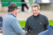 Actor Hugh Grant (right) chats with Dan Fireman, co-founder of Liberty National Golf Course, outside New York, on the first tee, before the third round of the Alfred Dunhill Links Championships 2018 at St Andrews, West Sands, Scotland on 6 October 2018.