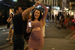 © Licensed to London News Pictures.  17/07/2021. London, UK. Members of the public make the most of Saturday night out in Soho, central London ahead of easing Lockdown restriction on 19 July (Monday). Photo credit: Marcin Nowak/LNP