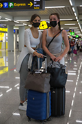 © Licensed to London News Pictures.  30/06/2021. Palma de Mallorca, Spain. Zan and Emilly from Manchester arrive at Palma Airport in Mallorca as Balearic Islands are on the UK 'green list' from 4am, today. Photo credit: Marcin Nowak/LNP