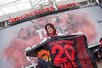 Football - Premier League 2012 / 2013 - Manchester United vs. Swansea<br /> A fan holds a 'Champions' flag at Old Trafford