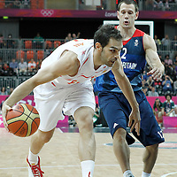 02 August 2012: Spain Jose Calderon drives past Great Britain Nate Reinking during 79-78 Team Spain victory over Team Great Britain, during the men's basketball preliminary, at the Basketball Arena, in London, Great Britain.