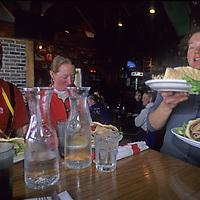 SKIING, Big Sky, Montana.  Friends enjoy lunch at Whiskey Jack's Restaurant.