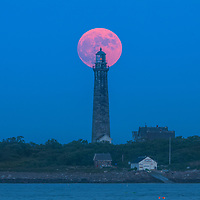 Picturesque New England lighthouse photos are available as museum quality photography prints, canvas prints, acrylic prints, wood prints or metal prints. Fine art prints may be framed and matted to the individual liking and interior design decorating needs:<br /> <br /> https://juergen-roth.pixels.com/featured/thacher-island-south-tower-with-full-buck-moon-juergen-roth.html<br /> <br /> Good light and happy photo making!<br /> <br /> My best,<br /> <br /> Juergen