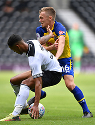 """Derby County's Max Lowe (left) and Southampton's James Ward-Prowse battle for the ball during a pre season friendly match at Pride Park, Derby. PRESS ASSOCIATION Photo. Picture date: Saturday July 21, 2018. Photo credit should read: Anthony Devlin/PA Wire. EDITORIAL USE ONLY No use with unauthorised audio, video, data, fixture lists, club/league logos or """"live"""" services. Online in-match use limited to 75 images, no video emulation. No use in betting, games or single club/league/player publications."""