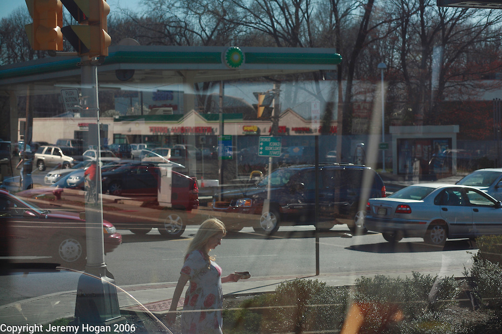 Pedestrians cross a chaotic congested street in Suburban New Jersey. ..