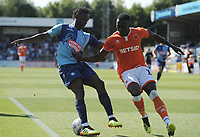 Blackpool's Joe Dodoo vies for possession with Wycombe Wanderers' Anthony Stewart<br /> <br /> Photographer Kevin Barnes/CameraSport<br /> <br /> The EFL Sky Bet League One - Wycombe Wanderers v Blackpool - Saturday 4th August 2018 - Adams Park - Wycombe<br /> <br /> World Copyright © 2018 CameraSport. All rights reserved. 43 Linden Ave. Countesthorpe. Leicester. England. LE8 5PG - Tel: +44 (0) 116 277 4147 - admin@camerasport.com - www.camerasport.com