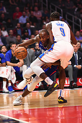October 19, 2018 - Los Angeles, CA, U.S. - LOS ANGELES, CA - OCTOBER 19: Los Angeles Clippers Forward Luc Mbah a Moute (12) drives against Oklahoma City Thunder Forward Jerami Grant (9) during a NBA game between the Oklahoma City Thunder and the Los Angeles Clippers on October 19, 2018 at STAPLES Center in Los Angeles, CA. (Credit Image: © Brian Rothmuller/Icon SMI via ZUMA Press)