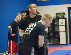 Stef Noij, KMG Instructor from the Institute Krav Maga Netherlands, helps Alan at the IKMS G Level Programme seminar, at the Scottish Martial Arts Centre, Alloa.