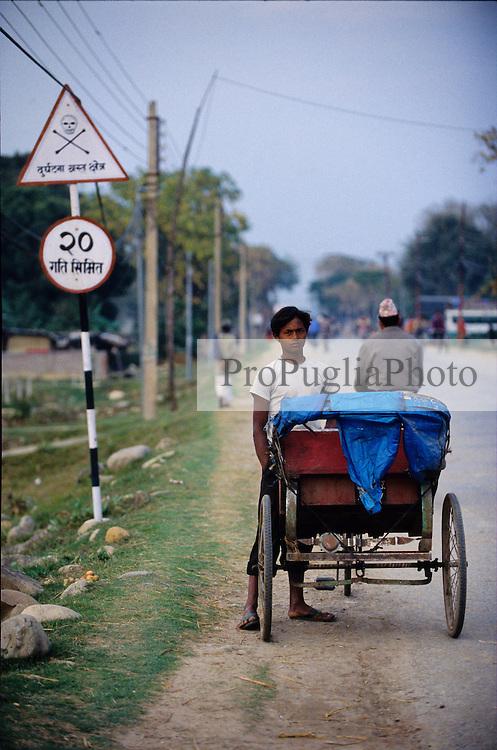 Nepalganj, 24 February 2005.  A rickshaw driver is waiting for customers