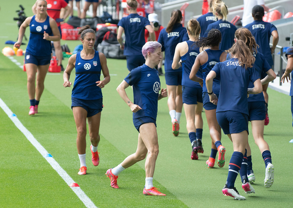 MEGAN RAPINOE (c) and members of the United States Women's National Team (USWNT) warm up at the new Q2 soccer stadium in Austin during one of the final games on their road to the 2021 Tokyo  Olympics. The team will play a friendly with Nigeria on Wednesday evening.