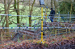 "© Licensed to London News Pictures. 11/12/2019. Gerrards Cross, UK. A police officer walks down a temporary structure designed for easier site access as the Metropolitan Police Service continues to search woodland in Gerrards Cross, Buckinghamshire. Police have been in the area conducting operations since Thursday 5th December 2019. In a press statement issued on 7th December, a Metropolitan Police spokesperson said ""Officers are currently in the Gerrards Cross area of Buckinghamshire as part of an ongoing investigation.<br /> ""We are not prepared to discuss further for operational reasons."" Photo credit: Peter Manning/LNP"