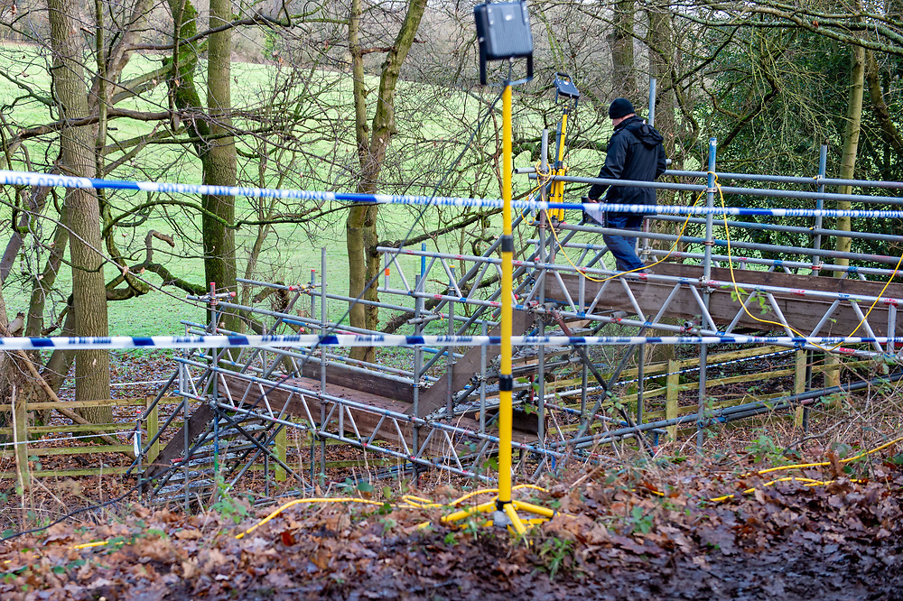 """© Licensed to London News Pictures. 11/12/2019. Gerrards Cross, UK. A police officer walks down a temporary structure designed for easier site access as the Metropolitan Police Service continues to search woodland in Gerrards Cross, Buckinghamshire. Police have been in the area conducting operations since Thursday 5th December 2019. In a press statement issued on 7th December, a Metropolitan Police spokesperson said """"Officers are currently in the Gerrards Cross area of Buckinghamshire as part of an ongoing investigation.<br /> """"We are not prepared to discuss further for operational reasons."""" Photo credit: Peter Manning/LNP"""