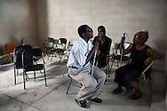 Program participants talk after a meeting at Société Haïtienne d'Aide aux Aveugles, a CBM partner providing services to the blind, in Port-au-Prince, Haiti.
