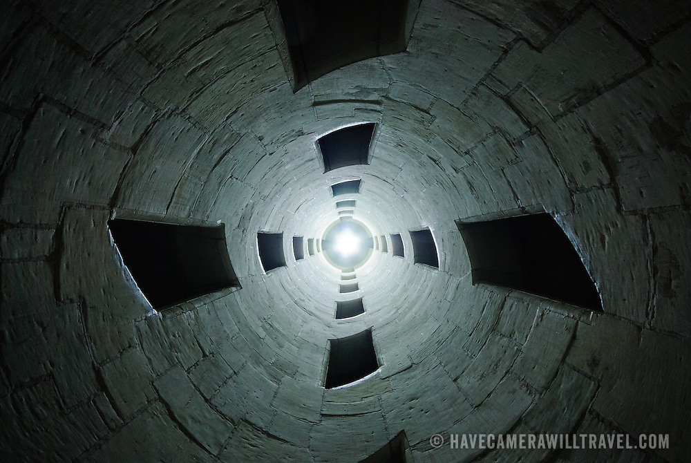 Inside the famous helix staircase at Chateau de Chambord in the Loire Valley, France. The shot is taken from ground level looking up the column.