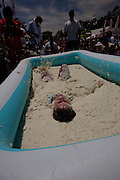 ST GEORGE, SC - APRIL 18: A participant rolls around in a giant vat of grits April 18, 2009 during the World Grits Festival in St. George, SC. The winner is the one who can hold the most of the stick grits to their body.     (Photo Richard Ellis)