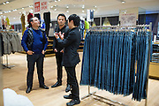 Media, fashionistas, bloggers, and corporate guests participate and shop during a private grand opening of the UNIQLO store at the Great Mall of the Bay Area in Milpitas, California, on October 30, 2014. (Stan Olszewski/SOSKIphoto)