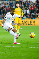 Football - 2017 / 2018 Premier League - Swansea City vs. Brighton & Hove Albion<br /> <br /> Luciano Narsingh of Swansea City shoots at goal, at The Liberty Stadium.<br /> <br /> COLORSPORT/WINSTON BYNORTH