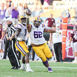 Sep 26, 2020; Baton Rouge, Louisiana, USA; LSU Tigers nose tackle Siaki Ika (62) reacts with defensive lineman Ali Gaye (11) against the Mississippi State Bulldogs during the second half at Tiger Stadium. Mandatory Credit: Derick E. Hingle-USA TODAY Sports