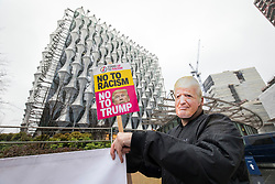 © Licensed to London News Pictures. 20/01/2018. London, UK. A protester wearing a Donald Trump mask at a demonstration outside the new American Embassy in Nine Elms on the first anniversary of Trump's inauguration as US President. Trump has cancelled his planned February 2018 visit to the UK and has described the new embassy as a 'bad deal'. Photo credit: Rob Pinney/LNP