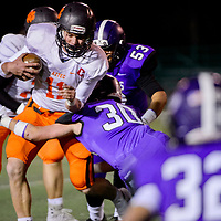 Aztec Tiger Cody Smith (11) fights through the Miyamura Patriots defense Friday at Angelo DiPaolo Stadium in Gallup.