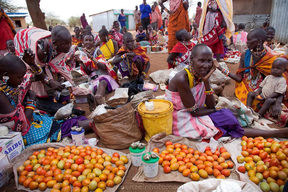 Vendors sell vegetables and fruit outside a marketplace pub in Narok, Kenya.
