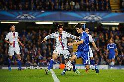 Chelsea Midfielder Oscar (BRA) is challenged by Basel Defender Taulant Xhaka (SUI) during the second half of the match - Photo mandatory by-line: Rogan Thomson/JMP - Tel: 07966 386802 - 18/09/2013 - SPORT - FOOTBALL - Stamford Bridge, London - Chelsea v FC Basel - UEFA Champions League Group E