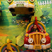 Young children enjoy the attractions at Lotte World.  Lotte World is the world's largest indoor theme park which includes shopping malls, a luxury hotel, and an Ice rink. Opened on July 12, 1989, Lotte World receives over 8 million visitors each year. Seoul, South Korea. 21st March 2012. Photo Tim Clayton