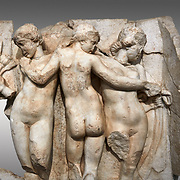 Close up of a Roman Sebasteion relief  sculpture of the Three Graces, Aphrodisias Museum, Aphrodisias, Turkey.  <br /> <br /> The Three Graces stand in their familiar hellenistic composition. They were handmaids of Aphrodite and appeared in this form on the decoration of her cult statue at Aphrodisias. Their names evoked their character: Euphrosyne (joy), Aglaia (Splendour) and Thaleia (Bloom).