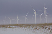 Wind turbines rise above the winter landscape near the Columbia River Gorge, Oregon.