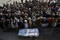 Pakistani Shiite Muslims attend a funeral ceremony of a suicide blast victim in northwest Pakistan's Peshawar, on Feb. 14, 2015. At least 19 people were killed and over 40 others injured in a twin suicide attack at a mosque of Shia Muslims in Pakistan's northwestern provincial capital of Peshawar Friday afternoon, officials said. EXPA Pictures © 2015, PhotoCredit: EXPA/ Photoshot/ Umar Qayyum<br /> <br /> *****ATTENTION - for AUT, SLO, CRO, SRB, BIH, MAZ only*****