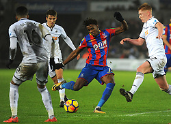 Wilfried Zaha of Crystal Palace is surrounded by Martin Olsson and Sam Clucas of Swansea City- Mandatory by-line: Nizaam Jones/JMP- 23/12/2017 - FOOTBALL - Liberty Stadium - Swansea, Wales - Swansea City v Crystal Palace- Premier League