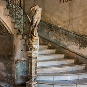 A haunting statue and stairwell in the building that houses the restaurant La Guarida, where the movie Strawberries and Chocolate was filmed.