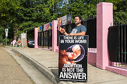 Pro-life activist Keith Dalton, 28, protests outside the Jackson Women's Health Organization clinic, on Tuesday August 19, 2014, in Jackson, Mississippi. This is the only clinic in the entire state that performs abortions. (Photo © Jock Fistick)