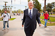 "14 MARCH 2011 - PHOENIX, AZ: TOM HORNE, Arizona's Republican Attorney General, walks across the plaza at the Arizona State Capitol in Phoenix Monday. Horne has supported toughening the state's anti-immigrant laws and eliminating ""ethnic studies"" programs in the state's public schools. Protests by immigrants' rights activists have continued as the state's conservative Republican legislators debate toughening the state's anti-immigrant bills. Some of the bills the state legislature has debated this year include eliminating birthright citizenship, a law that would require hospitals to check the immigration status of patients checking in for elective care, a bill that would require schools to verify the immigration status of students when they enroll and a bill that would require law enforcement to impound the cars of undocumented immigrants even if they have a legal driver's license from another state.      Photo by Jack Kurtz"