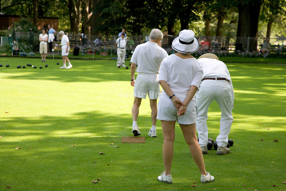 group of elderly people bowling in Central Park New York